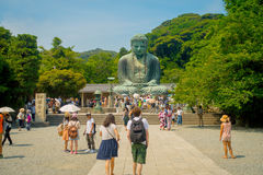 TOKYO, JAPAN JUNE 28 - 2017: Crowd of people posing and taking pictures at monumental bronze statue of the Great Buddha royalty free stock photos