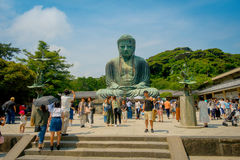 TOKYO, JAPAN JUNE 28 - 2017: Crowd of people posing and taking pictures at monumental bronze statue of the Great Buddha Royalty Free Stock Photography