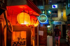 TOKYO, JAPAN JUNE 28 - 2017: Red lanterns with Japanesse letters at night in traditional back street bars in Shinjuku Royalty Free Stock Photo