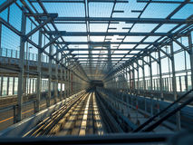 TOKYO, JAPAN JUNE 28 - 2017: Scenery of a train traveling on the elevated rail of Yurikamome Line in Odaiba, Minato Royalty Free Stock Images