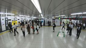 Tokyo, Japan - June 20, 2018 : Time-lapse of Japanese people, crowd, commuters in a hurry walking and running at Shinjuku JR railw. Ay train station in Tokyo stock video footage
