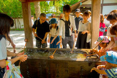 TOKYO, JAPAN JUNE 28 - 2017: Unidentified people at Kotokuin Temple in Kamakura, Japan, wash basin and dippers for Stock Photography