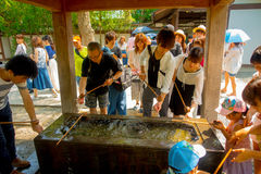 TOKYO, JAPAN JUNE 28 - 2017: Unidentified people at Kotokuin Temple in Kamakura, Japan, wash basin and dippers for Stock Image