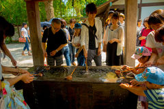 TOKYO, JAPAN JUNE 28 - 2017: Unidentified people at Kotokuin Temple in Kamakura, Japan, wash basin and dippers for Royalty Free Stock Images