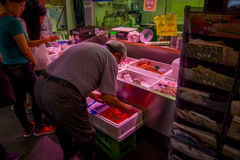 TOKYO, JAPAN JUNE 28 - 2017: Unidentified people selling and buying seafood packed inside of plastic boxes at Fish. Market Tsukiji wholesale in Tokyo Japan stock photo