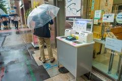 TOKYO, JAPAN JUNE 28 - 2017: Unidentified people walking under the rain in the sidewalk with umbrellas in Jimbocho Stock Photography