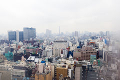 Tokyo Skyline Through Misty Hotel Window Stock Images