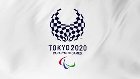 TOKYO, JAPAN, MARCH 2018: Logo of the paralympic Olympics in Tokyo 2020 fluttering in the wind 2 in 1. TOKYO, JAPAN, MARCH 2018: Logo of the paralympic Olympics stock video footage