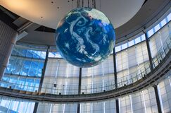 Low angle view of the earth globe Geo Cosmos in Miraikan museum of Odaiba.