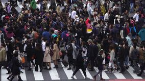 Time Lapse of people and cars across at Shibuya famous crossing street in Tokyo, Japan