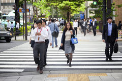 TOKYO, JAPAN - MAY 19: Businessman during lunch break in business district Nishi-Shinjuku on May 19, 2016 in Tokyo, Japan. TOKYO, JAPAN - MAY 19: Office people Stock Images
