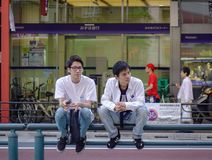 A gay couple sitting on street of Tokyo royalty free stock photo