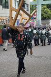 Tokyo, Japan - May 14, 2017:Man carrying a stand for the shrine. Tokyo, Japan - May 14, 2017: Traditional dressed man is carrying a stand for the shrine at the royalty free stock photography