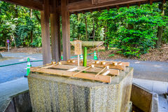 TOKYO, JAPAN: Original Japanese blessing well to pray for good health and happiness located in Meiji Shrine, Shibuya, stock photos
