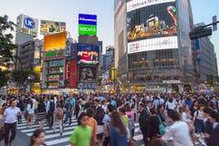 TOKYO, JAPAN - MAY 13, 2015: Pedestrians walk at Shibuya Crossin Royalty Free Stock Photos