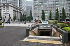 Tokyo. JAPAN - MAY 9, 2012: People walk by Hibiya Station entrance of  Metro, Japan. With more than 3.1 billion annual passenger rides,  subway system is the royalty free stock photography