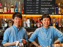 Tokyo, Japan - May 06: Uidentified friendly staff at Nui Hostel smiles at camera on May 06, 2014 in Tokyo, Japan. stock photography
