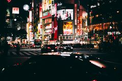 View of the busy Shibuya crossing in Tokyo at night with intent. TOKYO, JAPAN - MAY 17, 2018: View of the busy Shibuya crossing in Tokyo at night with stock image
