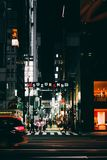 View of the busy streets of Ginza in Tokyo ar night with intent. TOKYO, JAPAN - MAY 17, 2018: View of the busy streets of Ginza in Tokyo ar night with royalty free stock photo