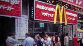 TOKYO, JAPAN -1972: McDonalds hamburgers sold at one of the 1st foreign franchises. Unique vintage 8mm film home movie professionally cleaned and captured in 4k stock footage