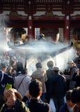 TOKYO, JAPAN - NOV 21: Buddhists Gather Around A Fire To Light I Stock Photo