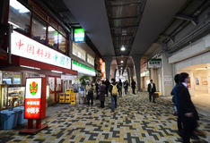 TOKYO, JAPAN - NOV 26: Passengers visit retail shops on November. 26, 2013 around Yurakucho station, Japan royalty free stock photos