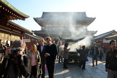 TOKYO, JAPAN - NOV 21: Buddhists gather around a fire to light i Royalty Free Stock Image
