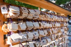 Tokyo, Japan - 20 NOV, 2016:ema in Meiji Jingu Shrine, who come. To worship the shrine to write a prayer or desire. Then put the wooden plate to the place where stock image