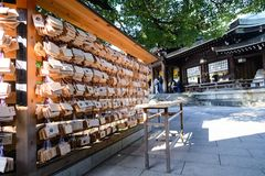 Tokyo, Japan - 20 NOV, 2016:ema in Meiji Jingu Shrine, who come. To worship the shrine to write a prayer or desire. Then put the wooden plate to the place where royalty free stock images