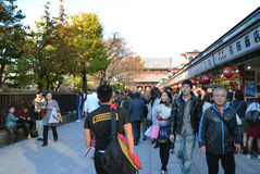 TOKYO, JAPAN - NOV 21 : Nakamise shopping street in Asakusa, Tok. Yo on 21 November 2013. The busy arcade connects Senso-ji Temple to it's outer gate Kaminarimon Royalty Free Stock Image