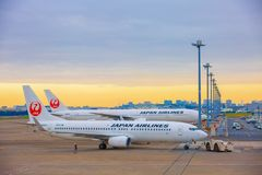 TOKYO, JAPAN - 26 NOVEMBER 2018. Japan Airlines or JAL plane at Haneda International Airport.In the morning stock photography