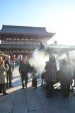 TOKYO, JAPAN - NOVEMBER 21: Buddhists gather around a fire to li Stock Photos