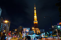 Tokyo, Japan - November 28, 2013: Busy street at night with Tokyo Tower Stock Image