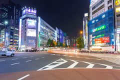 Cityscape of Shinjuku district with traffic lights on the street of Tokyo. Tokyo, Japan - November 14, 2016: Cityscape of Shinjuku district with traffic lights Royalty Free Stock Image