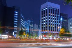 Cityscape of Shinjuku district with traffic lights on the street of Tokyo. Tokyo, Japan - November 14, 2016: Cityscape of Shinjuku district with traffic lights Royalty Free Stock Photo