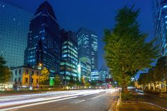 Cityscape of Shinjuku district with traffic lights on the street of Tokyo. Tokyo, Japan - November 14, 2016: Cityscape of Shinjuku district with traffic lights Stock Photography