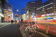 Cityscape of Shinjuku district with traffic lights. TOKYO, JAPAN - NOVEMBER 14, 2016: Cityscape of Shinjuku district with traffic lights on the street of Tokyo Stock Image