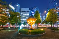 Cityscape of Shinjuku district with traffic lights. TOKYO, JAPAN - NOVEMBER 14, 2016: Cityscape of Shinjuku district with traffic lights on the street of Tokyo Royalty Free Stock Photos