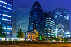 Cityscape of Shinjuku district with traffic lights on the street of Tokyo. Tokyo, Japan - November 14, 2016: Cityscape of Shinjuku district with traffic lights Stock Images
