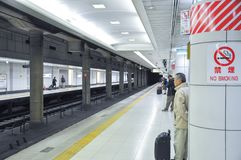 Tokyo, Japan:November 13, 2014 - Crowd of passengers are waiting stock photography