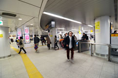 Tokyo, Japan - November 23, 2013: Crowd walking at Shibuya station Stock Photos