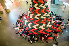 Roppongi Hills. Tokyo, Japan - November 30, 2018: The entire Christmas tree are made from soft and stretchy knitted fabric, visitors can sit and lie down on this stock images