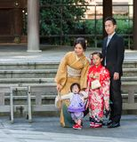 TOKYO, JAPAN - NOVEMBER 7, 2017: A family in a kimono is photographed in a city park. Copy space for text. TOKYO, JAPAN - NOVEMBER 7, 2017: A family in a kimono royalty free stock photo