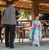TOKYO, JAPAN - NOVEMBER 7, 2017: Girl in a kimono near the temple Asakusa Schrein Senso-ji. TOKYO, JAPAN - NOVEMBER 7, 2017: Girl in a kimono near the temple royalty free stock image