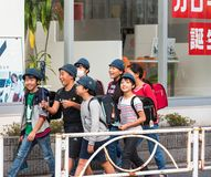 TOKYO, JAPAN - NOVEMBER 7, 2017: Group of children on a city street. TOKYO, JAPAN - NOVEMBER 7, 2017: Group of children on a city street royalty free stock photo