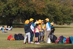 TOKYO, JAPAN - NOVEMBER 7, 2017: A group of japanese children in a city park. Copy space for text. TOKYO, JAPAN - NOVEMBER 7, 2017: A group of japanese children royalty free stock photography