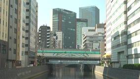Kanda river flowing at the south of Akihabara station viewed from Sakuma bridge stock video