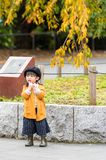 TOKYO, JAPAN - NOVEMBER 7, 2017: Little japanese girl in beret. Vertical. Copy space for text. stock photo