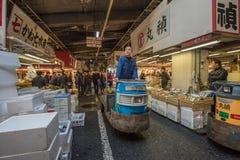 TOKYO, JAPAN - November, 22, 2014: A man driving taretto, motori Royalty Free Stock Image