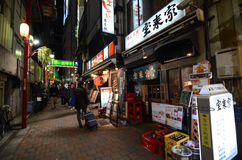 TOKYO,JAPAN - NOVEMBER 23: Narrow pedestrian street , The area is filled with tiny cheap restaurants Stock Images